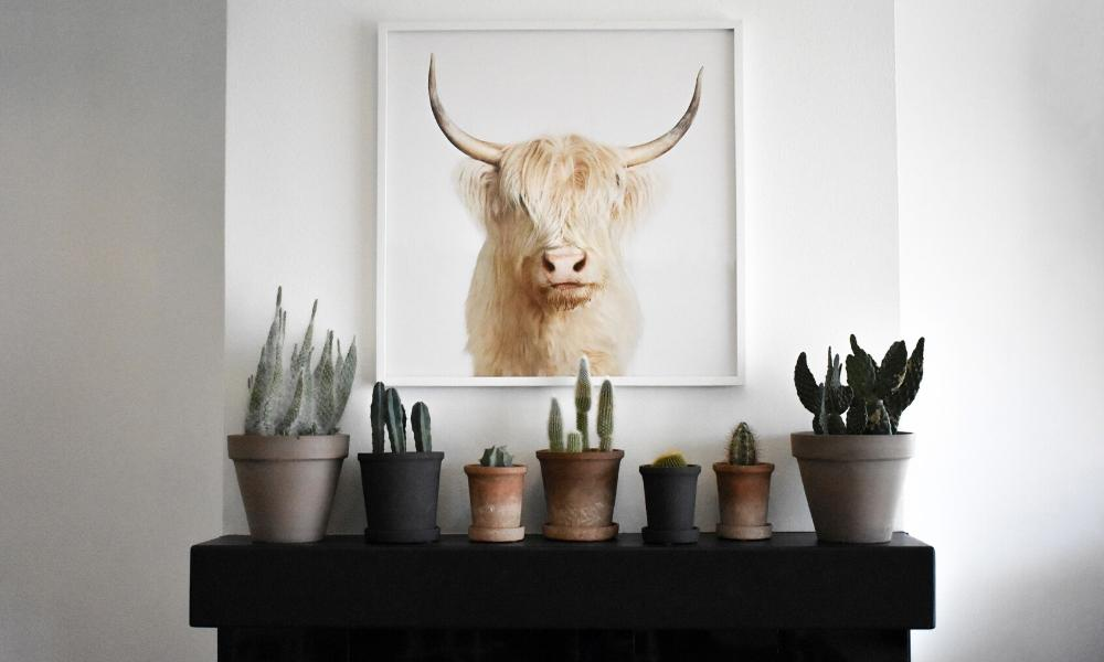 Simple mantel decor with scandi cow and plants